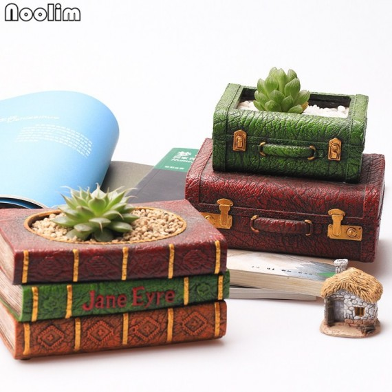 Pot encrusted in resin book lights - 1